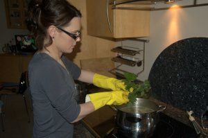 Adding the nettle leaves to soup
