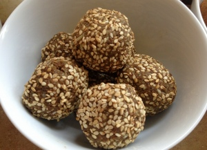 Finished sesame seed rolled hemp protein cocoa energy balls