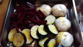 Ready to roast beets, mushrooms and courgettes